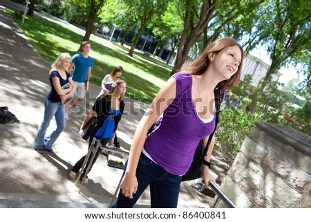 College students going to college - stock photo