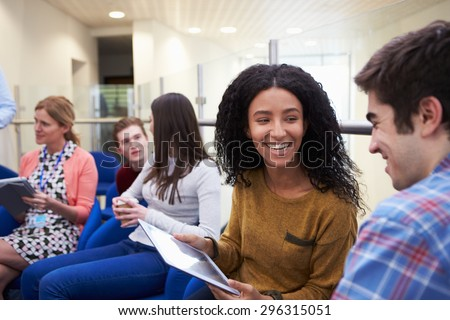 College Students Having Informal Meeting With Tutors - stock photo