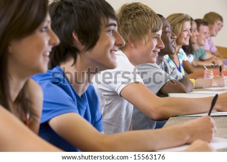 College students listening to a university lecture - stock photo