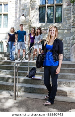 College students on the stairs of college building - stock photo