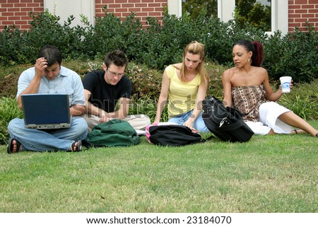 College students outside classroom or dorm. - stock photo