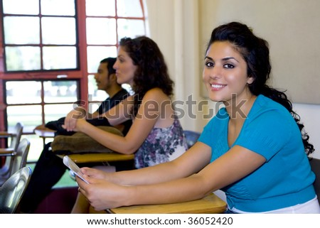 College students sitting in a classroom - stock photo