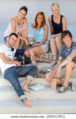 College students sitting on school stairs during break summer relaxing - stock photo