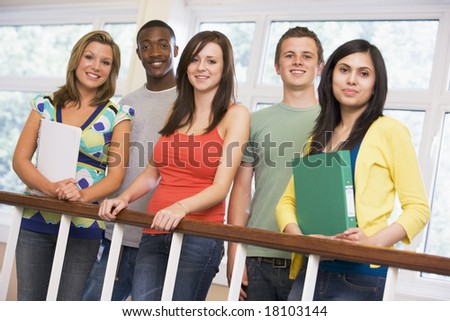 college students stood by staircase