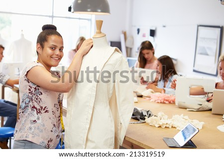 College Students Studying Fashion And Design - stock photo