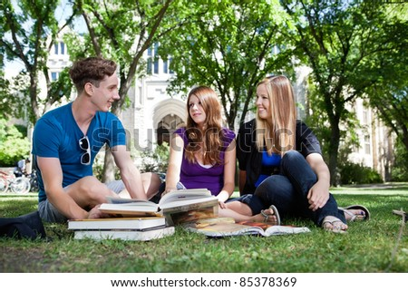 College students studying on university campus ground
