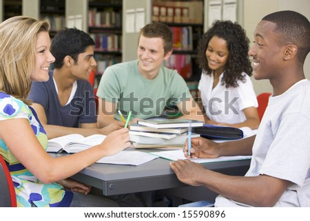 College students studying together in a library - stock photo