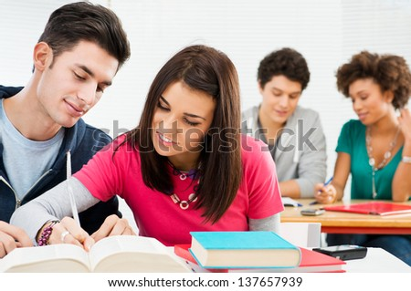 College Students Studying Together In Class