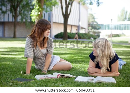 College students studying together on college campus - stock photo