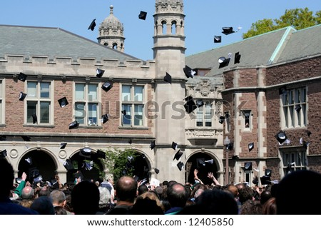 College students throwing caps on graduation