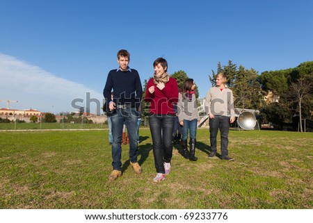College Students Walking and Talking at Park