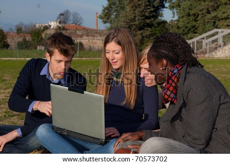 College Students with Computer at Park - stock photo