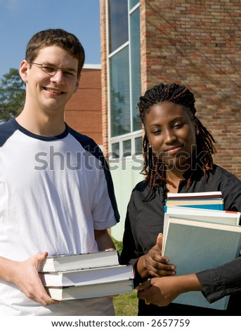 college students with too many textbooks to read - stock photo