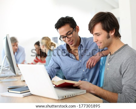 College students working together on project - stock photo