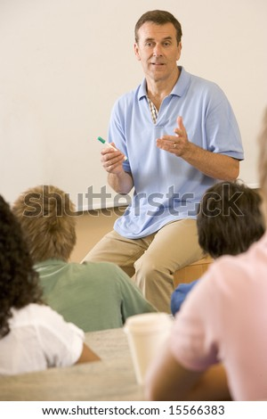 College teacher giving a lecture - stock photo