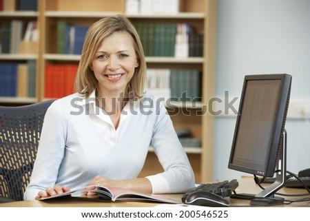 College tutor at work - stock photo
