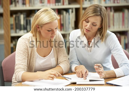College tutor with student - stock photo