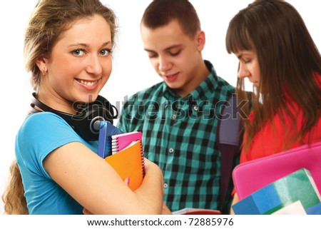 College younsters, focus on a girl holding books