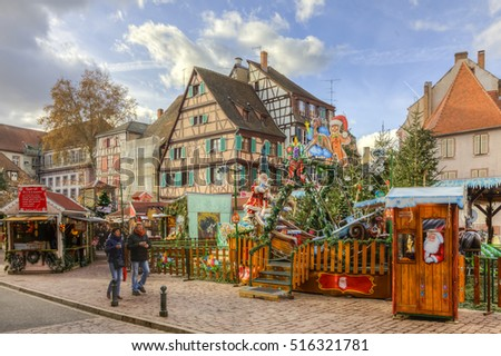 COLMAR,FRANCE-DEC 6: People passing in front of a playground for children decorated for winter holidays in Clomar,Alsace,France on December 6, 2013.