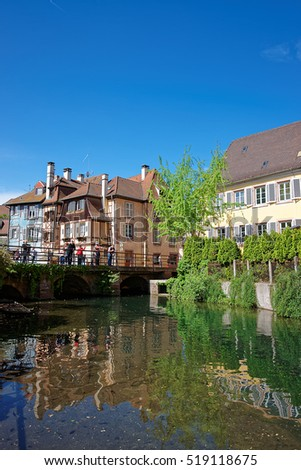 Colmar, France - May 1, 2012: Little Venice quarter and River Auch in Colmar, Haut Rhin at Alsace, France. People on the background