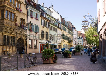 COLMAR, FRANCE - SEPTEMBER 10, 2010: A view in the old town of Colmar city. Alsace, France. Colmar is the capital of the Haut-Rhin department in Alsace. It is situated along the Alsatian Wine Route.  - stock photo