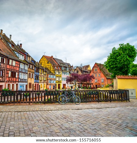 Colmar, Petit Venice, bridge on water canal, bike and traditional colorful houses. Alsace, France. - stock photo