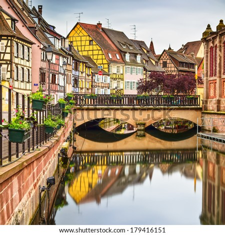 Colmar, Petit Venice, bridge, water canal and traditional colorful houses. Alsace, France. Long exposure. - stock photo