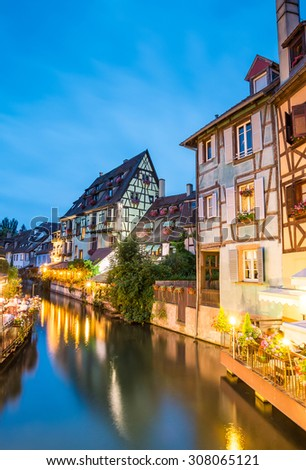 Colmar, Petit Venice, water canal and traditional colorful houses. Alsace, France. Long exposure.  - stock photo