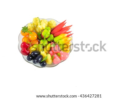 Coloful of Thai style marzipan fruits on dish isolate on white background