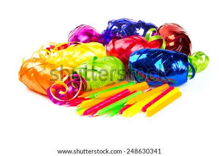 coloful ribbons and cake candles isolated on white