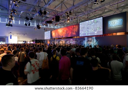 COLOGNE - AUGUST 18:  Huge crowds of gamers gathering at Activision Blizzard and Bethesda Booth at GamesCom 2011, the most important European video games Expo August 18, 2011 in Cologne, DE - stock photo