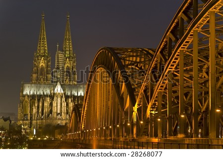 Cologne Cathedral and bridge at night - stock photo