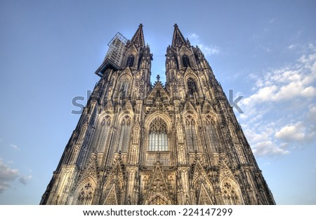Cologne Cathedral in Germany against a blue evening sky - stock photo