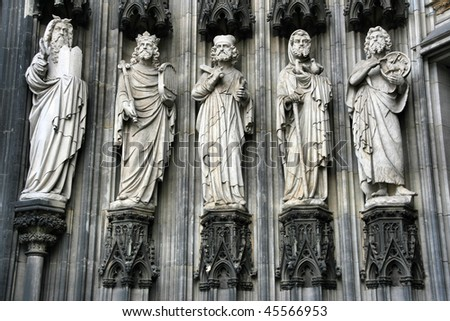 Cologne cathedral of Saint Peter and Mary - exterior statues. Famous church in Germany. Seat of Archbishop. UNESCO World Heritage Site. - stock photo