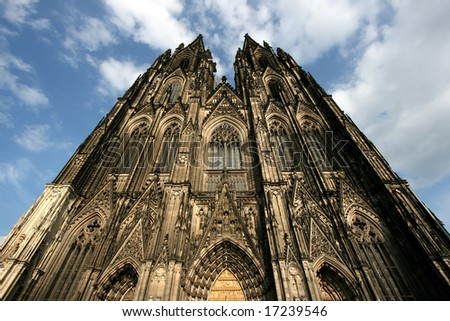 Cologne cathedral of Saint Peter and Mary in the light of setting sun. Famous church. Seat of Archbishop. UNESCO World Heritage Site. - stock photo
