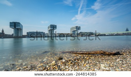 Cologne city panorama with cathedral and crane houses - stock photo