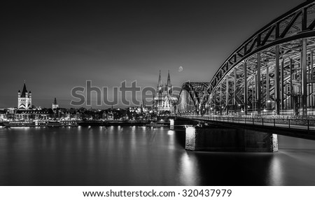 Cologne city with cathedral and Hohenzollern bridge in black and white colors, germany - stock photo