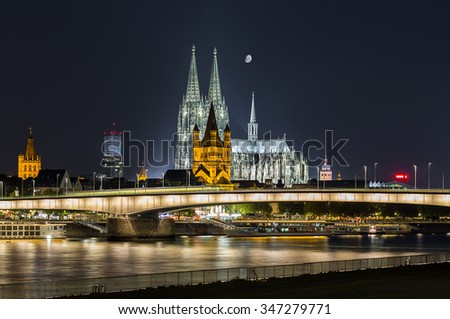 cologne city with Cathedral and moon in the sky in germany