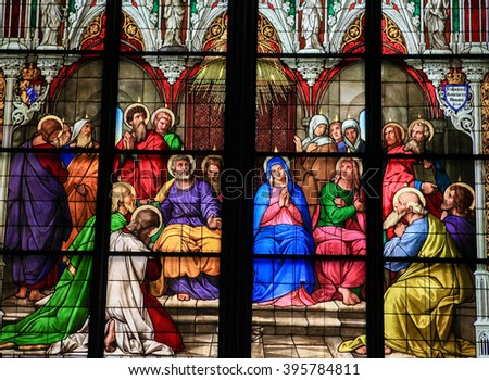 COLOGNE, GERMANY - APRIL 21, 2010: Stained glass church window depicting Pentecost in the Dom of Cologne, Germany. - stock photo