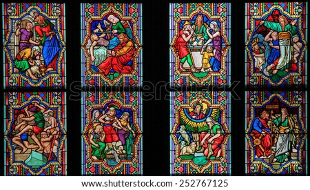 COLOGNE, GERMANY - APRIL 21, 2010: Stained Glass window depicting scenes in the Life of Moses in the Dom of Cologne, Germany. - stock photo
