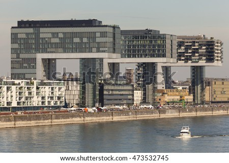COLOGNE, GERMANY - AUG 7, 2016: The Crane Houses at the Rhine river in Cologne are contemporary landmarks of the city. North Rhine-Westphalia, Germany