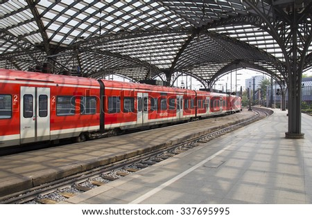 Cologne, Germany - August 30, 2013: Local German train leaves the historic railway station of Cologne, Germany on August 30, 2013 - stock photo