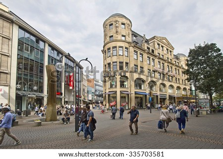 Cologne, Germany - August 27, 2013: People shopping in the Schildergasse street in Cologne on August 27, 2013 in Cologne, Germany - stock photo