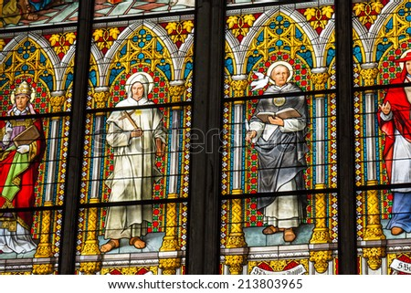 COLOGNE, GERMANY - AUGUST 26: Stained glass church window with Pentecost theme in the cathedral on August 26, 2014 in Cologne - stock photo