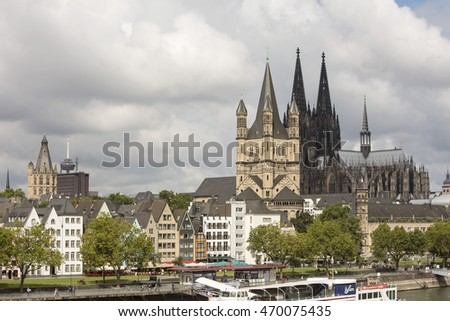 Cologne, Germany - August 10, 2016: Two Churches. St Martin Church and the great Cathedral of Cologne stand side by side in the skyline of Cologne.