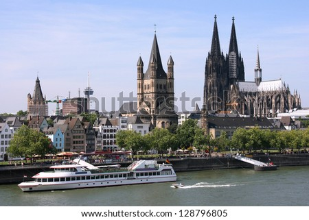 Cologne, Germany - cityscape with Rhine river and famous cathedral. Photo may seem tilted to the left - optical illusion. - stock photo
