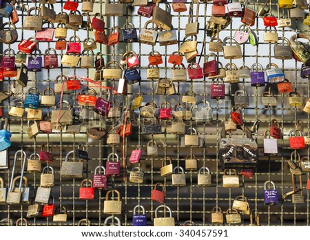 COLOGNE, GERMANY - DEC 3, 2013: lockers at the Hohenzollern bridge symbolize love for ever in Cologne, Germany. 40000 lockers of loving couples are on that heavily used railway bridge. - stock photo