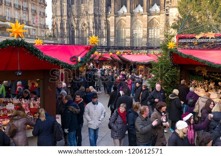 COLOGNE, GERMANY - DECEMBER 1: Lots of people at the christmas market on december 1, 2012 in Cologne, Germany. It's one of the largest in the country with 7 separate markets, all in the city center. - stock photo