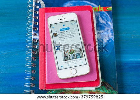 Cologne, Germany- February 21, 2016: Iphone 5 White with opened Twitter application on the table. - stock photo