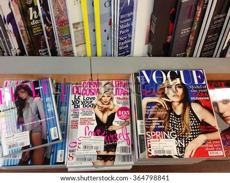 Cologne,Germany- February 23,2013: Popular british magazines in english language on display in a store in Cologne,Germany - stock photo